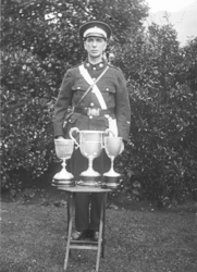 Unknown St John's Ambulance man with trophies