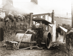 A council steamroller repairing roads in