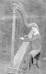 A young harpist in the garden of The Swan